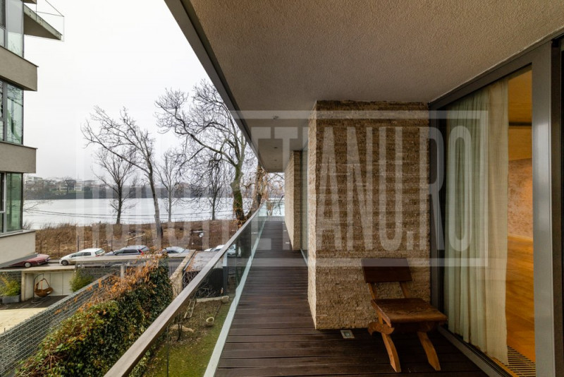 Lake view butique apartment with a pool